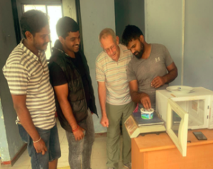 Gary Ruegsegger, second from the right, teaching new techniques to Sri Lankan dairy farmers