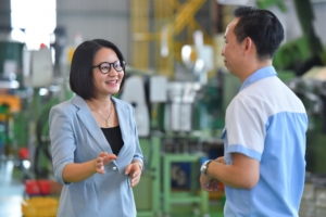 Ms. Pham Thu Mai discussing with Fastener Factory Manager about Tung Lam's integration into lead firm supply chains. Photo courtesy: USAID LinkSME